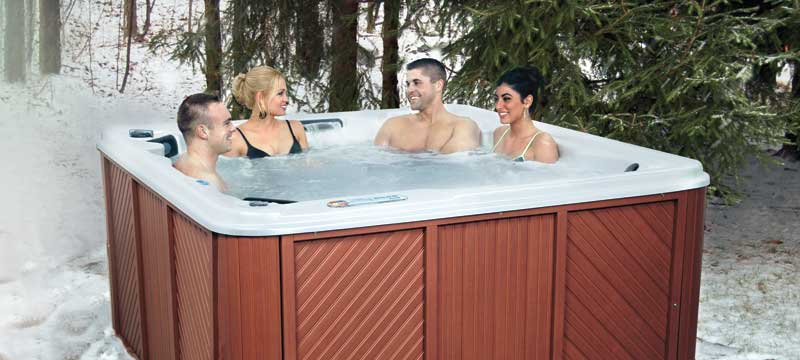 Couples enjoying QCA Spa with Dura-Frame Cabinet